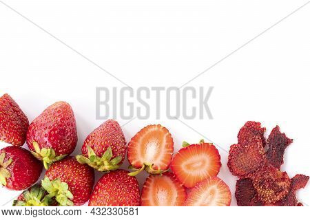 Healthy Sweets. Ripe Sweet Strawberries, Red Strawberry Slices, Dried Strawberry Pieces. Fruit Chips