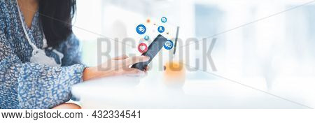 Hand Using Smart Phone With Social Media Concept