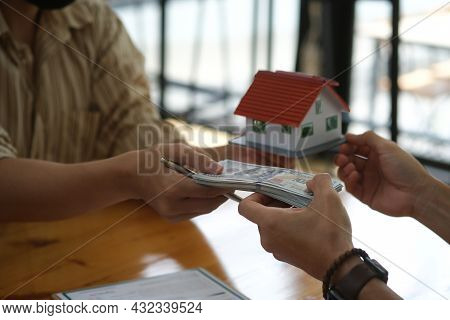 Closed Up With Exchange Between Cash And House, Mortgage And Loan Ownership, House Insurance Or Prop