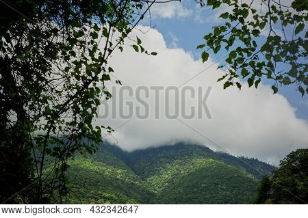 Clouds In The Green Peaks Of The Mountains. Abkhazia, The Country Of The Soul
