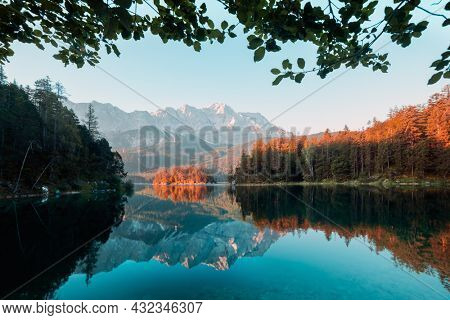 Fantastic morning on mountain lake Eibsee, located in the Bavaria, Germany. Dramatic unusual scene. Alps, Europe. Landscape photography