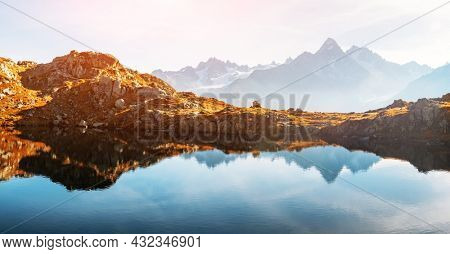 Picturesque panorama of Chesery lake (Lac De Cheserys) and snowy Monte Bianco mountains range on background, Chamonix, France Alps. Landscape photography