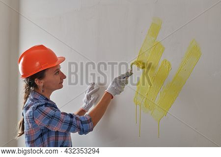 Beautifully Painted Yellow Wall With A Roller