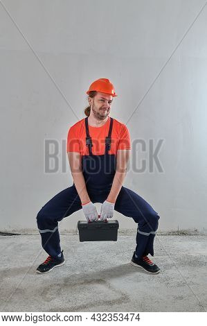 The Builder Has A Black Suitcase With Tools Very Heavy