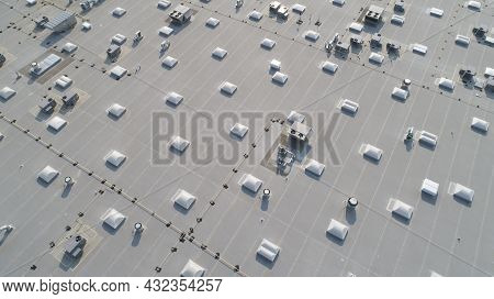 Aerial View Of Skylights And Hvac Equipment On Top Of A Commercial Roof Building