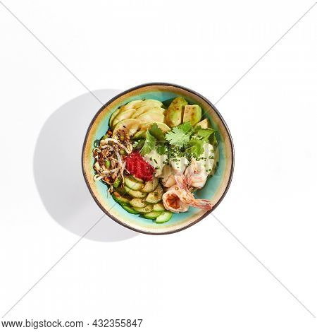 Healthy food - poke bowl with prawn, rice, fresh vegetables, edamame beans, soybean sprouts. Poke bowl with shrimp isolated on white background. Dinner for slimming. Salad bowl with prawn