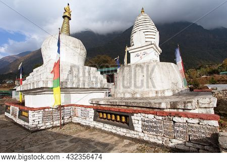Buddhist Stupa Or Chorten With Prayer Flags And Wheels On The Way From Lukla To Namche Bazar In Chau