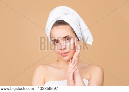 Beauty Face Of A Cheerful Attractive Girl With Towel On Head, Isolated. Moisturized Healthy Skin, Mo