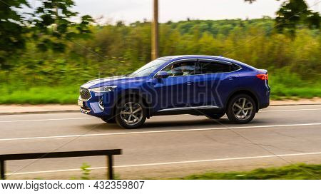 Haval F7x Five Door Suv Is Driving At High Speed On Country Road. Overspeed Out Of City Concept. Blu
