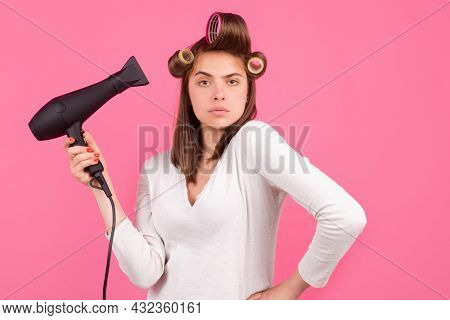 Young Funny Woman With Hair Dryer And Rollers. Woman With Hair Dryer. Beautiful Girl With Straight H