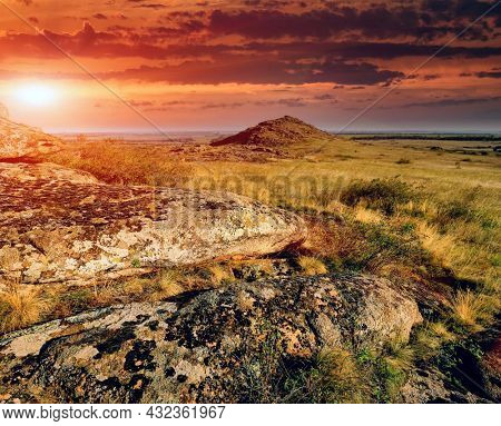 sunset landscape old over stones in steppe. Take it in Ukraine