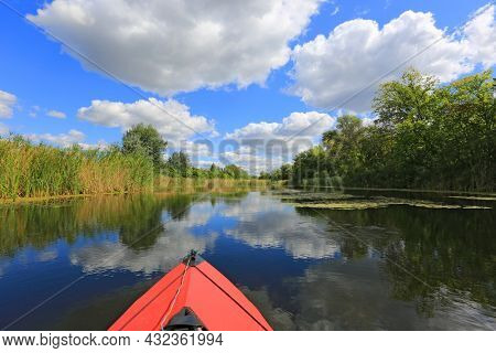 nice summer ladscape with canoe floating on river surface. Photo from Ukraine
