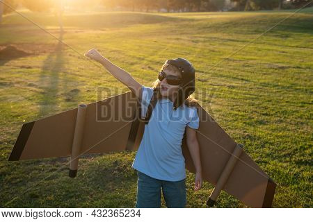 Child Playing With Toy Jetpack. Child Pilot Astronaut Or Spaceman Dreams Of Flight. Aviator Boy Flyi