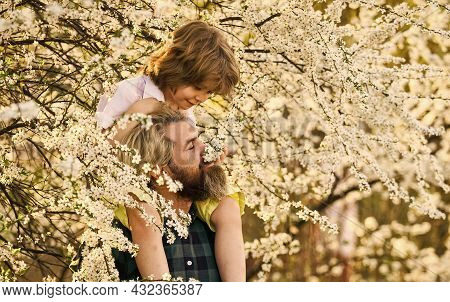 Playing With Daddy. Childhood And Parenthood Happiness. Love And Support. Father And Son At Tree. Sp
