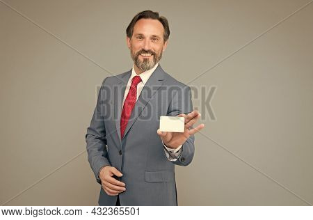 Mature Businessman Hold Business Card. Professional Auditor Man In Formal Suit. Confident Male Manag