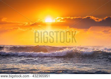 Beautiful Sunrise Wave And Dramatic Cloudscape During Scenic Sunrise Over The Sea