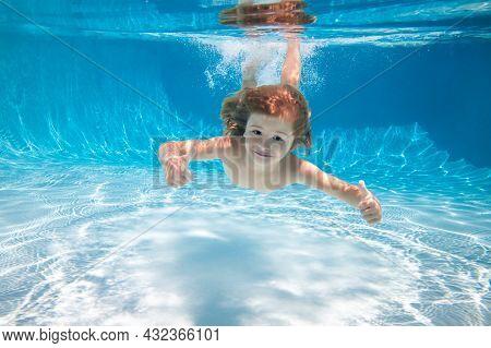 Happy Kid Boy Swim And Dive Underwater, Kid With Fun In Pool. Active Healthy Lifestyle, Watersport U