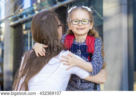 First Day In The Fall. Back To School Kids. Mother Lead Little Schoolgirl In Uniform, Schoolbag In T