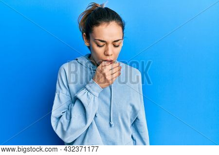 Young caucasian blonde woman wearing casual sweatshirt feeling unwell and coughing as symptom for cold or bronchitis. health care concept.