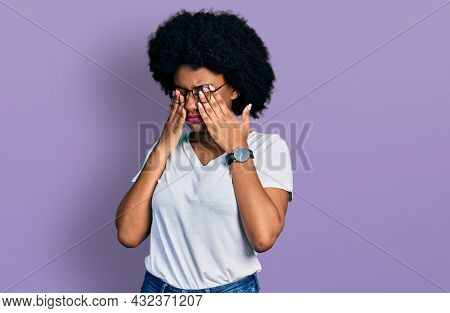 Young african american woman wearing casual white t shirt rubbing eyes for fatigue and headache, sleepy and tired expression. vision problem