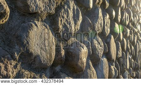 Real Backround With Grey Crushed Stones And Sunbeam. Old Brick Wall In A Summer Day. Abstract Decora