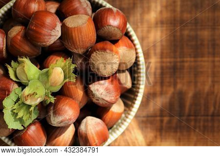 Hazelnut Abundance.nuts On The Table.nut Harvest. Ripe Nuts Plate And Green Nuts With Leaves On Wood