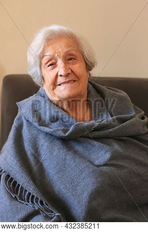 Portrait Of A Very Elderly Woman Close-up. Positive Ninety Year Old Grandmother