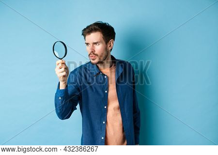 Serious Man Investigating Or Searching For Something, Look Through Magnifying Glass Like Detective,