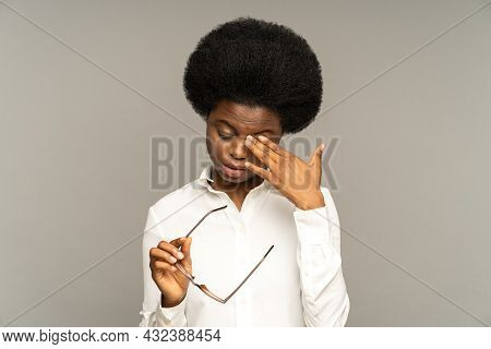 Sleepy Young African Business Woman Taking Off Glasses Rubbing Eyes Feels Tired After Work On Laptop