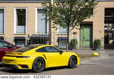 St. Petersburg, Russia - July 09, 2021: Yellow Sports Car In Parking Near The House In St. Petersbur