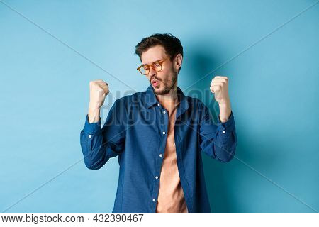 Successful Guy Dancing And Triumphing In New Eyewear, Raising Hands Up In Fist Pump Gesture, Say Yes