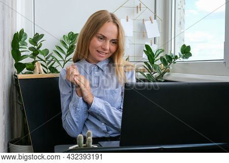 Young Woman Working On A Computer At Home, Calculating Monthly Exspences, Doing Home Budgeting. Busi