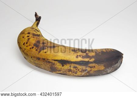 Overripe Banana In Yellow Peel With Brown Spots. With Clipping Path