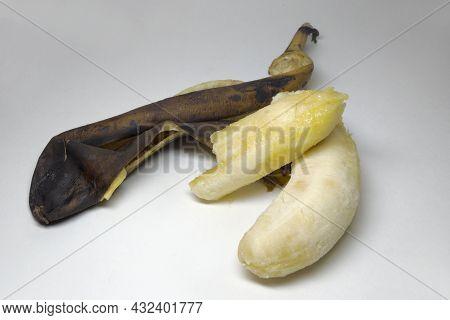 Peeled Overripe Banana. Fresh Pulp Under Brownish Rotten Skin