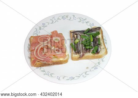 Slices Of Salted Salmon And Smoked Sprat, On White Toast Bread With Butter, Seasoned With Chopped Sh