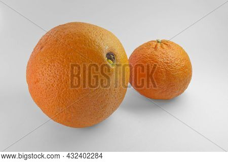 Orange And Ripe Tangerine On White Background. With Clipping Path