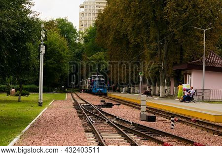 Kyiv, Ukraine-august 22, 2021:scenic Travel Landscape. Diesel Locomotive With Several Cars Approache
