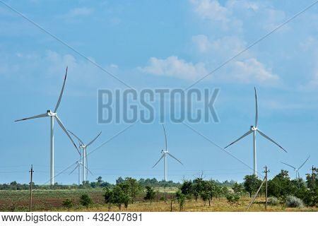 Wind Farm With High Wind Turbines For Generation Electricity. Green Energy Concept. Windmill Park Al