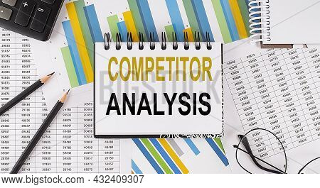 Closeup A Notebook With Text Competitor Analysis , Business Concept Image On The Chart Background