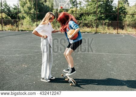 Two Friends Are Learning To Skate, The Girls Help Each Other And Support Each Other. Friends, Friend
