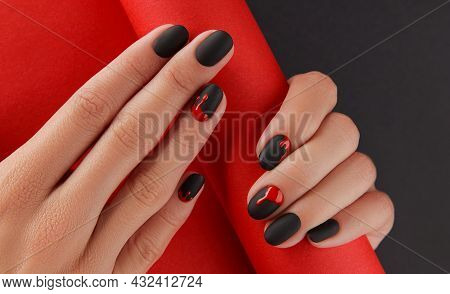 Manicured Female Hands With Fashion Accessories. Trendy Autumn Halloween Bloody Spooky Nail Design.