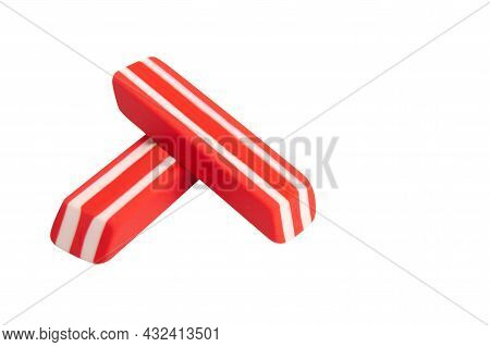Two Red And White Erases, On A White Background, Close-up