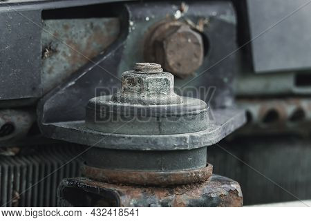 Workshop, Locksmith Work. Master Unscrews The Nut With The Head . Removing Or Installing A Car Radia