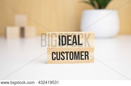 On A Light Background, Wooden Cubes And A Wooden Block With The Text Ideal Customer. View From Above