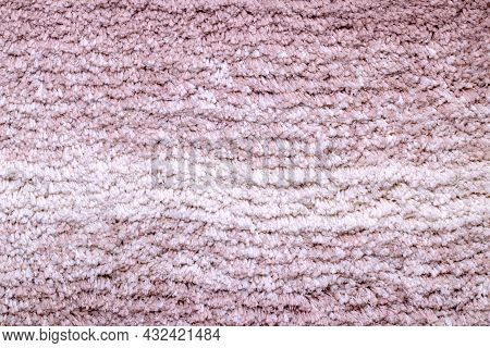 Red Brown Fabric Texture. Close-up Of A Pink Fluffy Soft Bath Mat Or Rug Or Textile Background. Macr