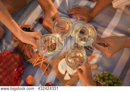 Group Of Friends Having Picnic On Blanket, Top View