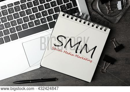 Notebook With Text Smm (social Media Marketing) And Laptop On Grey Table, Flat Lay