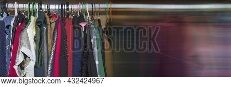 Panoramic Banner. Wardrobe With Clothes Hanging On Different Colored Hangers. Colorful Clothes Hangi