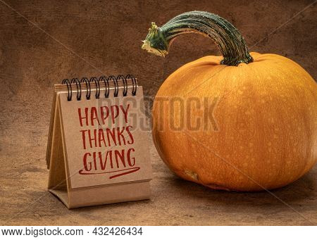Happy Thanksgiving - handwriting in a desktop calendar with a pumpkin, fall holiday greetings