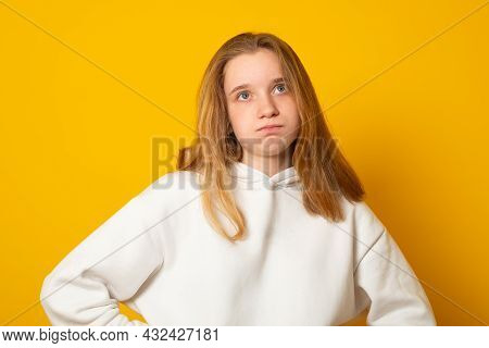 Negative Emotions, Discontent. Peevish Offended Young Girl With Trendy Hairstyle Curving Her Lips Lo